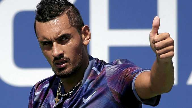 Nick Kyrgios reacts after scoring a point against John Millman.