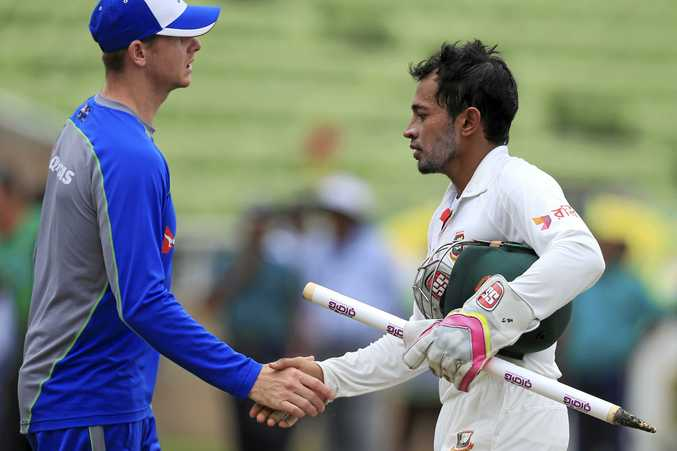 Bangladesh captain Mushfiqur Rahim, right, shakes hand with  Steve Smith after the hosts' victory in Dhaka.