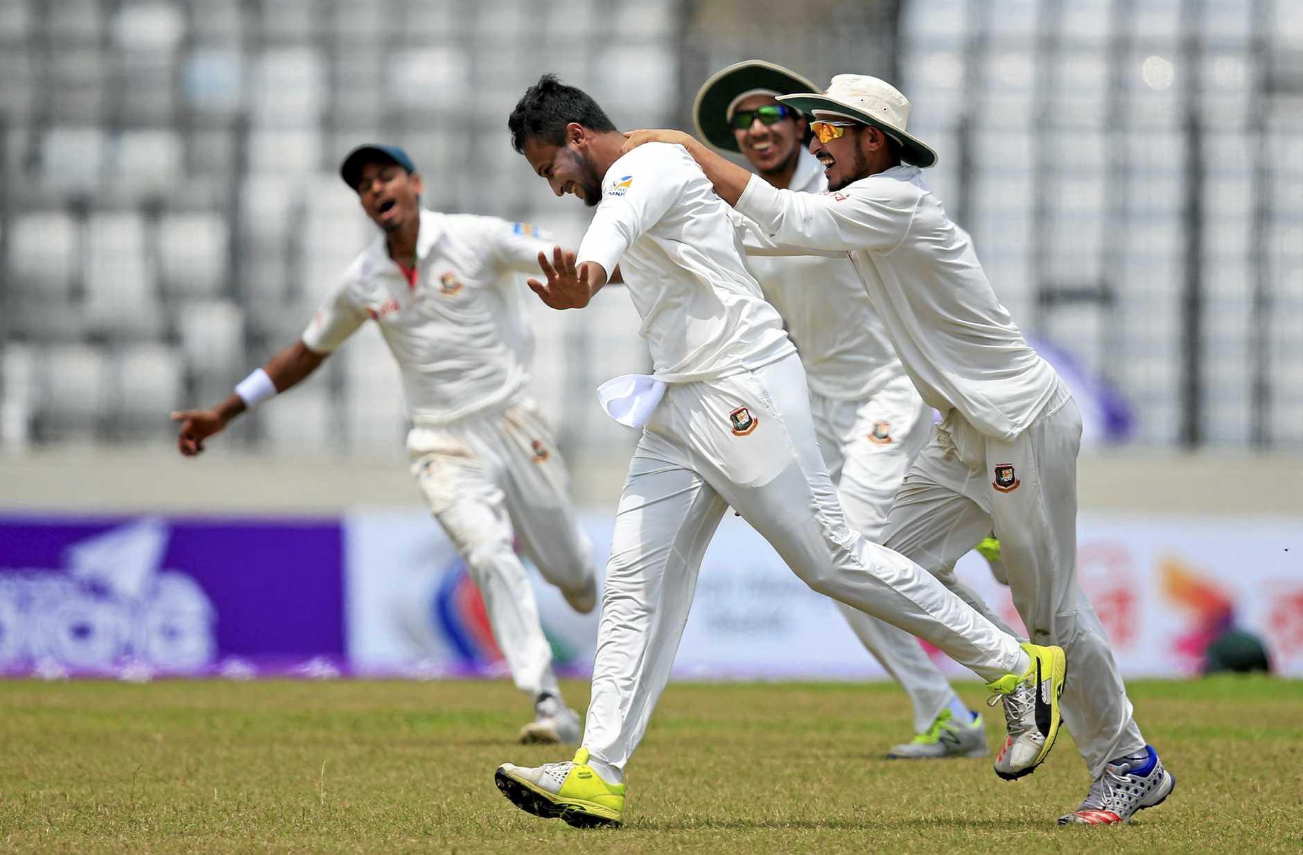 Teammates congratulate Bangladesh's Sakib Al Hasan, second left, after the dismissal of Australia's Glenn Maxwell