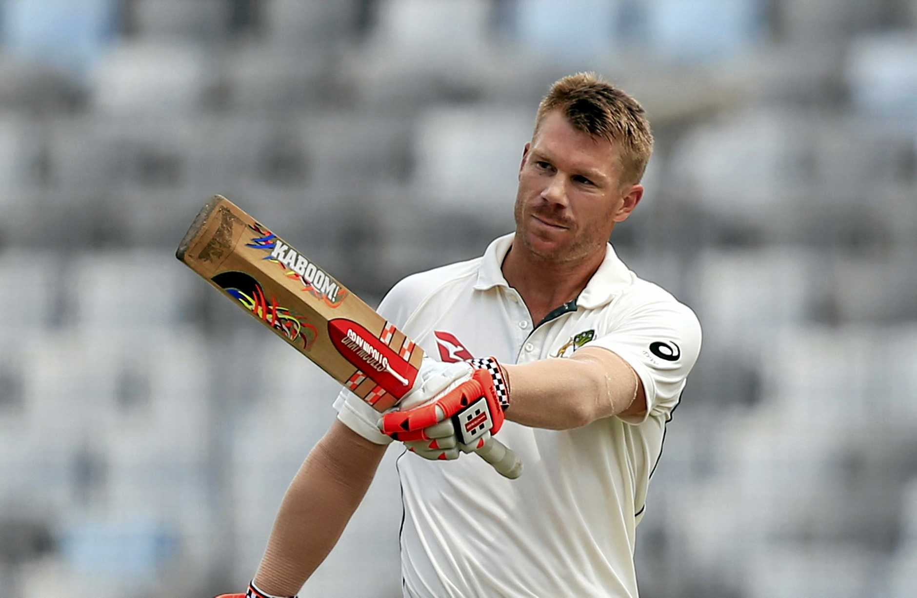 Australia's David Warner acknowledges the crowed after scoring a century