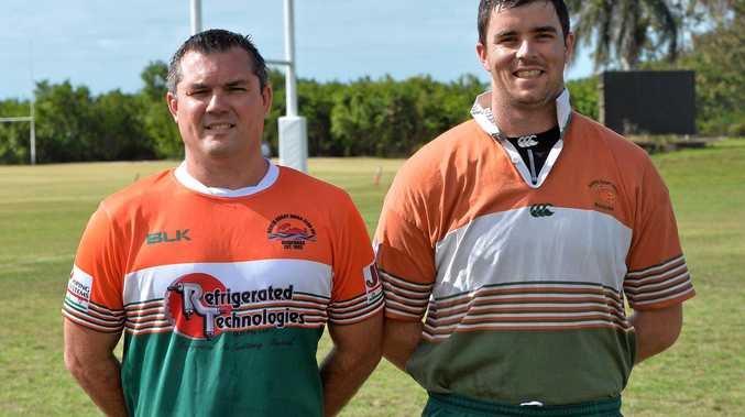 Bowen Mudcrabs coach Andrew Mitchell sporting the new jerseys modelled from the former stripe worn by Tim O'Brien.