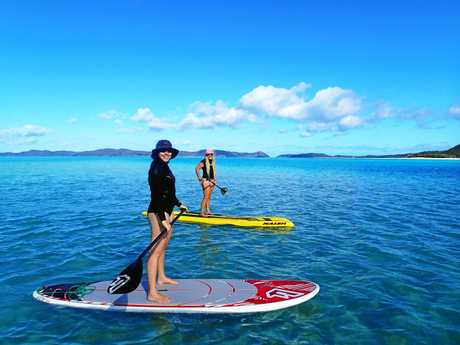 FUN TIME: Competitors at the last Whitsunday Stand-up Paddleboard Challenge.