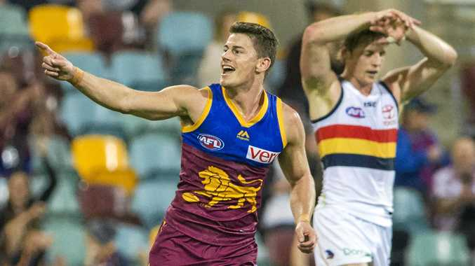 Dayne Zorko of the Lions celebrates after scoring a goal against the Crows in round nine.