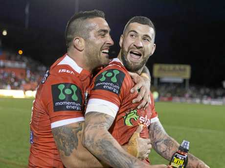 Joel Thompson (right) with Dragons teammate Paul Vaughan.