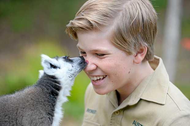 Robert Irwin with a lemur.