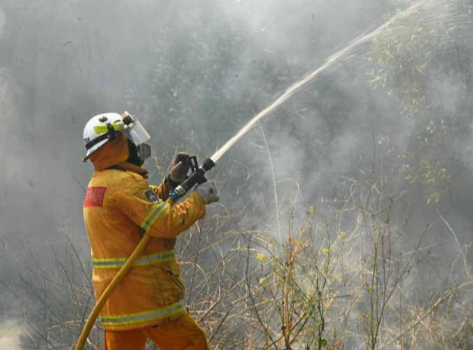 FILE PHOTO: A Rural Fire Service volunteer fights a bushfire.