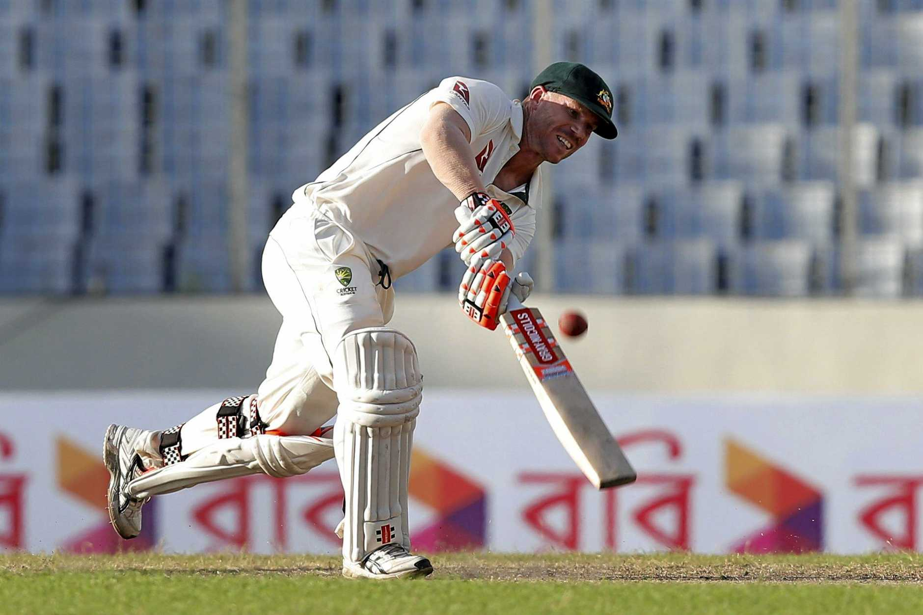 Australia's David Warner plays a shot against Bangladesh in Dhaka.