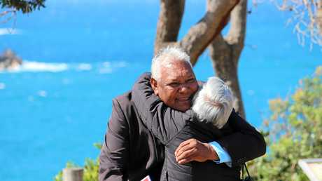 An emotional Billy Walker receives a hug on Pilot Hill following the Native Title determination on August 31, 2017.
