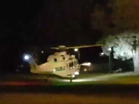 A helicopter leaves the scene after a man was shot dead by police. Picture: Brian Van De Wakker