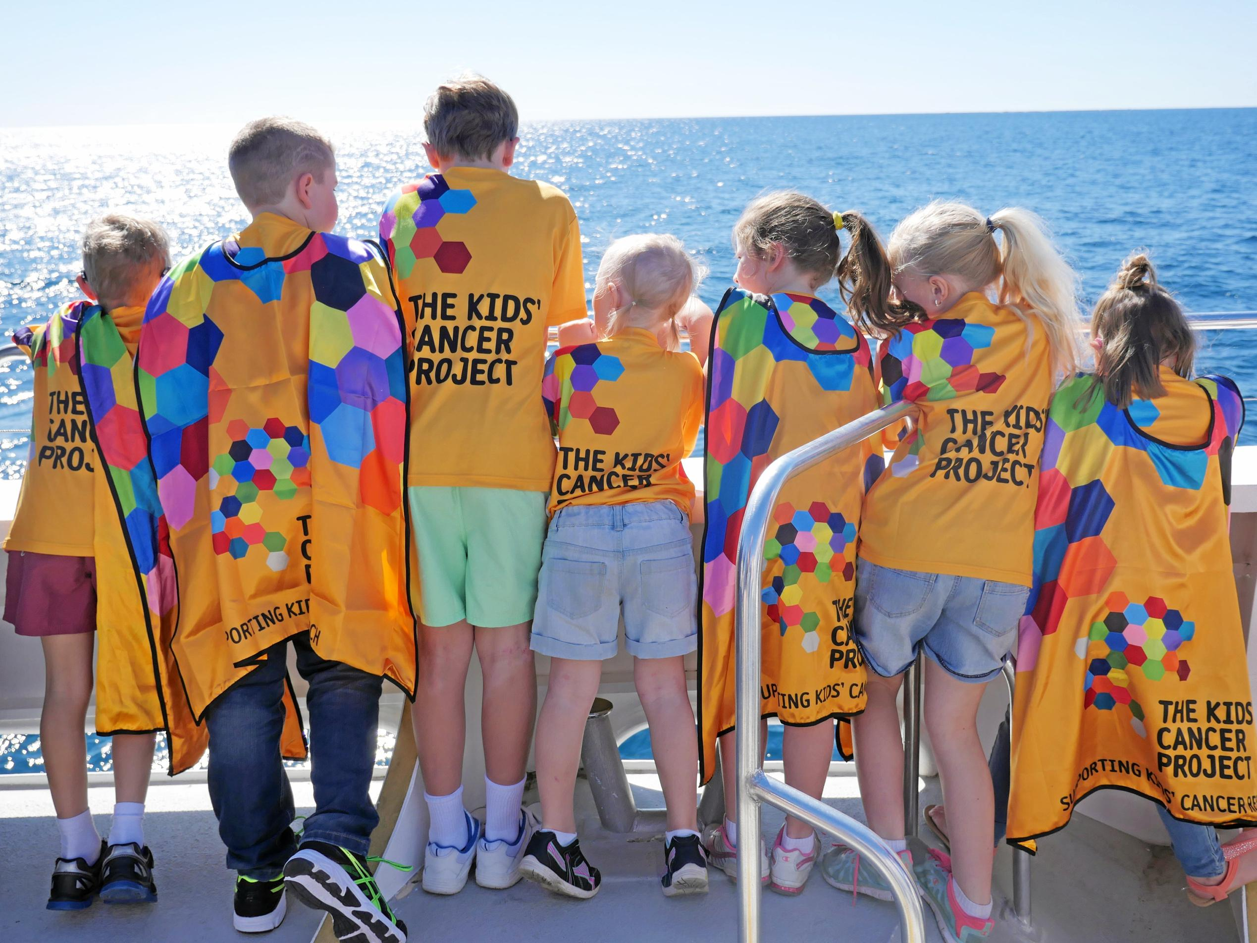 Children from The Kids' Cancer Project trying to see whales.