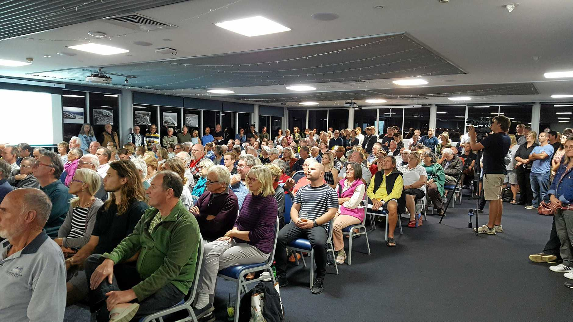 FIRED UP: A massive crowd took to the Maroochy Surf Life Saving Club last night to oppose a possible rock wall at the river mouth.