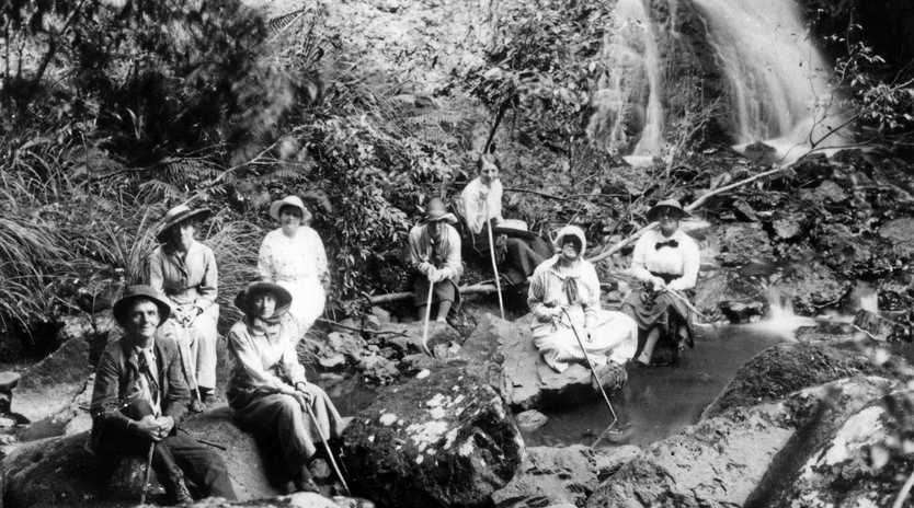 COOL AND GREEN: Hikers rest at Bon Accord Falls, Montville, ca 1918.