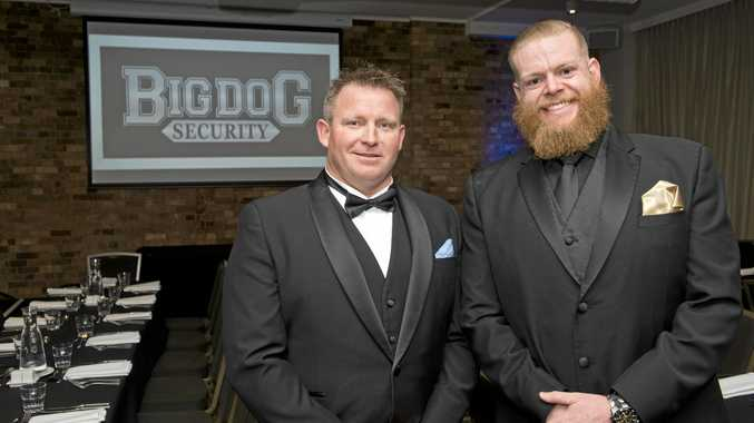 Big Dog Security managing directors Jamie Law (left) and Kurt Schulte-Schrepping celebrate achievements of their staff.