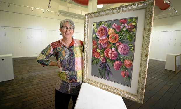 RETURN HOME: Kath Dunne with one of the paintings in her exhibition at the Walter Reid Art Gallery over the weekend. Kath grew up in Rockhampton and moved to Duaringa to her husband's family farm after she was married.