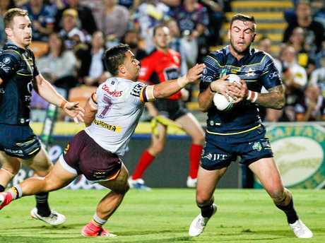 Kyle Feldt of the Cowboys makes his way around Kodi Nikorima of the Broncos