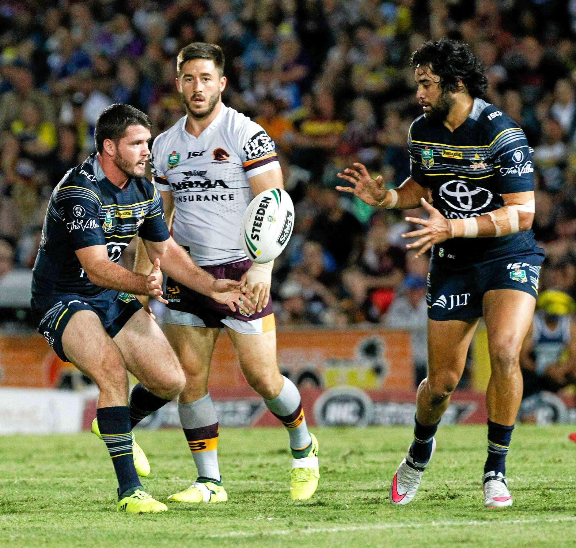 Lachlan Coote of the Cowboys gets a pass away to team mate Javid Bowen