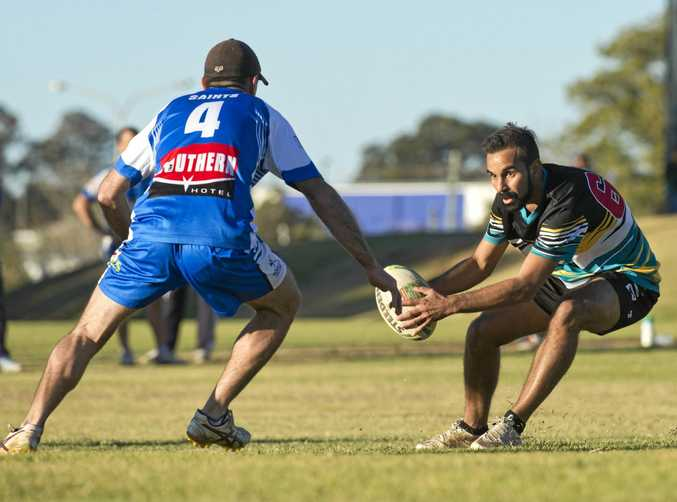Andrew Ryan of Saints (left) and Cody Green, Rebels Hurricanes, face off in their semi-final clash last month.