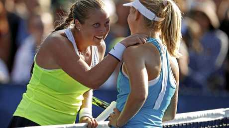 Shelby Rogers (left), of the United States, talks with Daria Gavrilova, of Australia, after Rogers won their second-round match at the US Open.