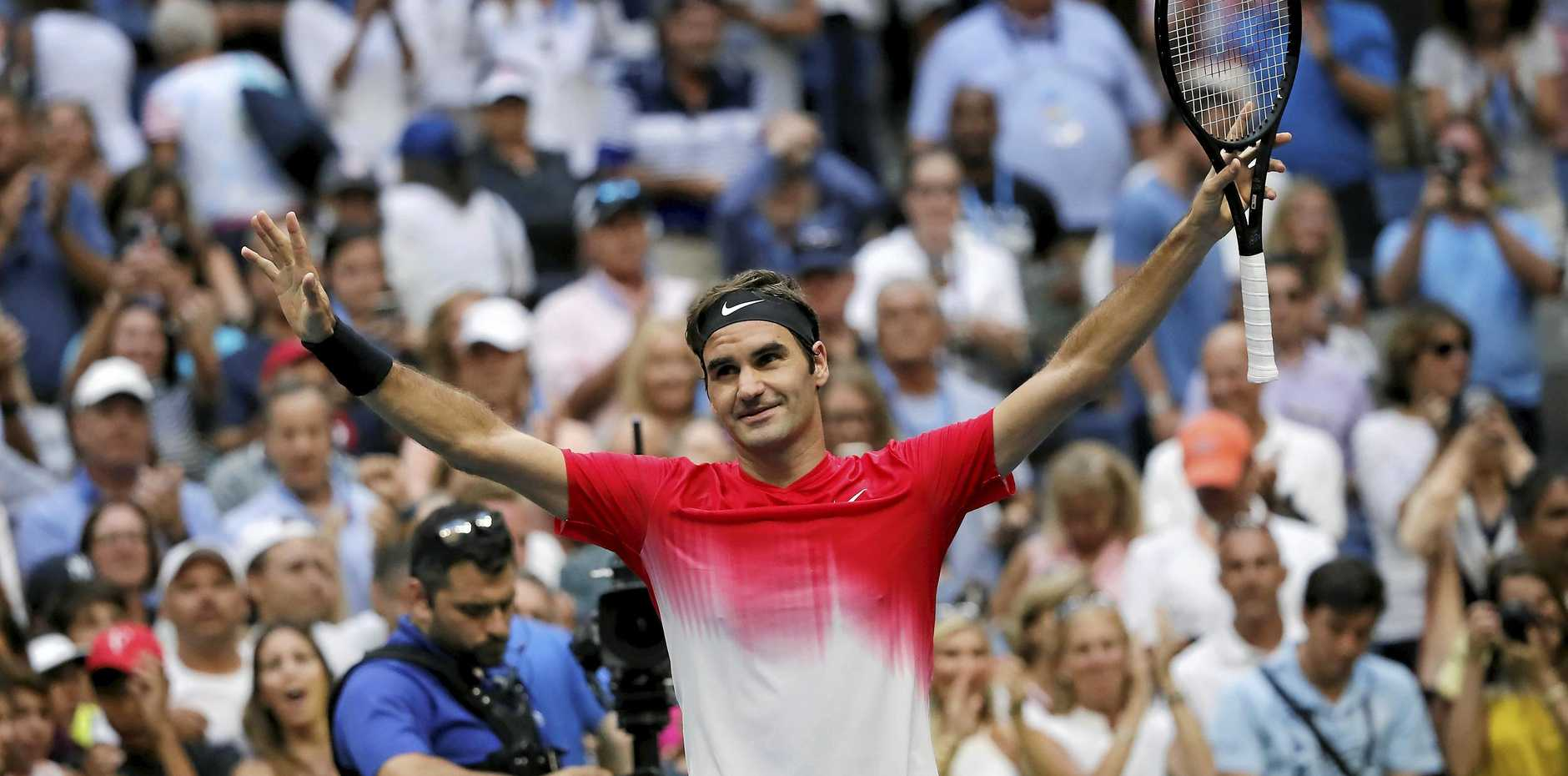 Roger Federer, of Switzerland, reacts after defeating Mikhail Youzhny, of Russia, during the second round of the U.S. Open