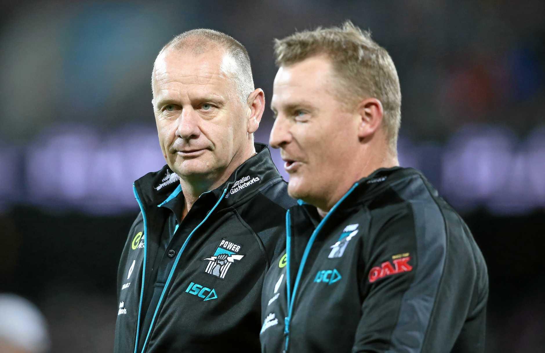 Port Adelaide coach Ken Hinkley (left) talks with assistant coach Michael Voss.