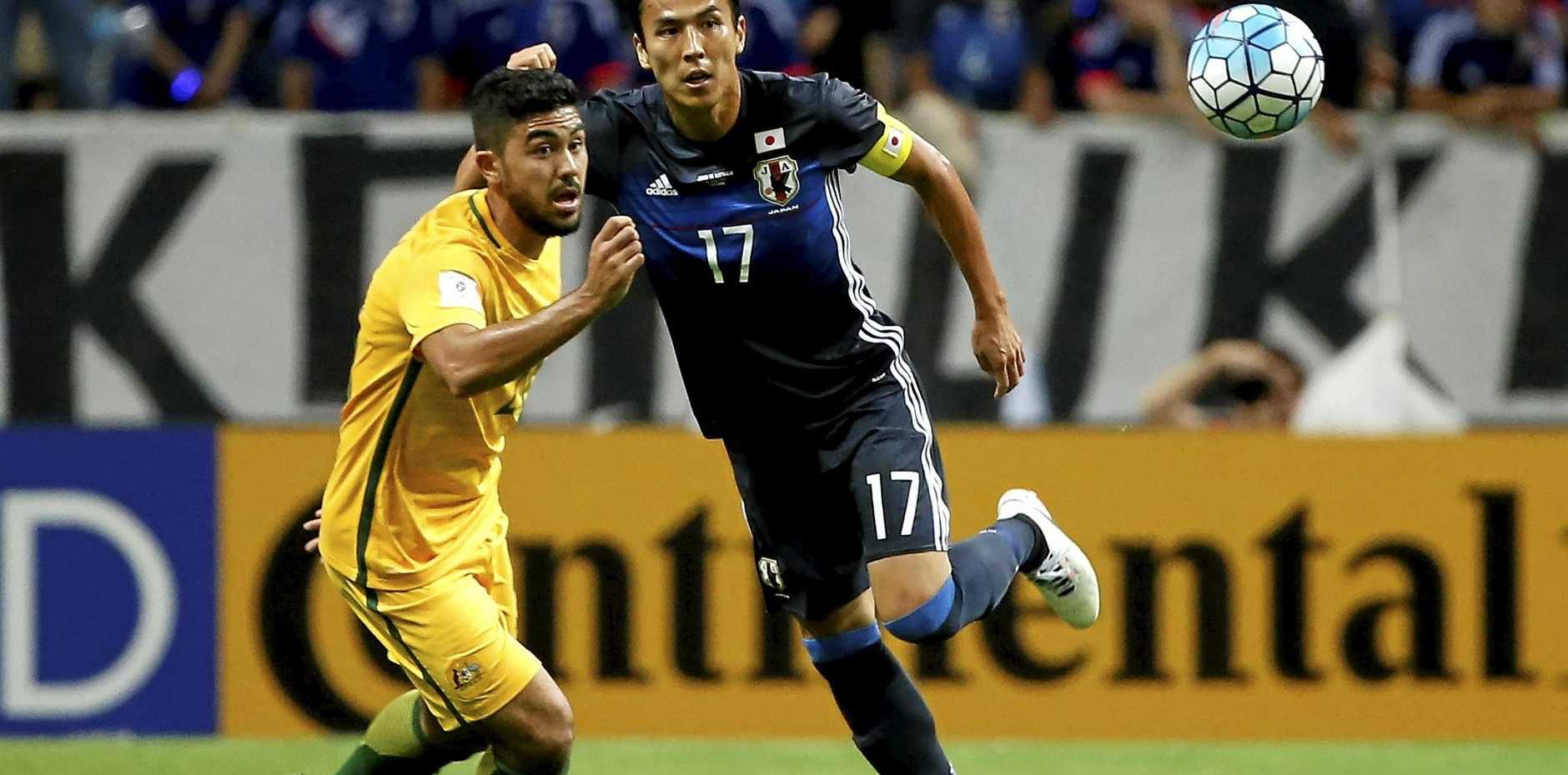 Japan's Makoto Hasebe and Australia's Massimo Luongo during their World Cup Group B qualifying match in Saitama.