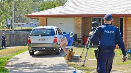 CRIME SCENE: Senior sergeant Adrian Brock at the fatal stabbing in South Gladstone.
