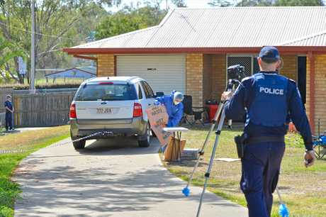 CRIME SCENE: Senior sergeant Adrian Brock at the fatal stabbing in South Gladstone.