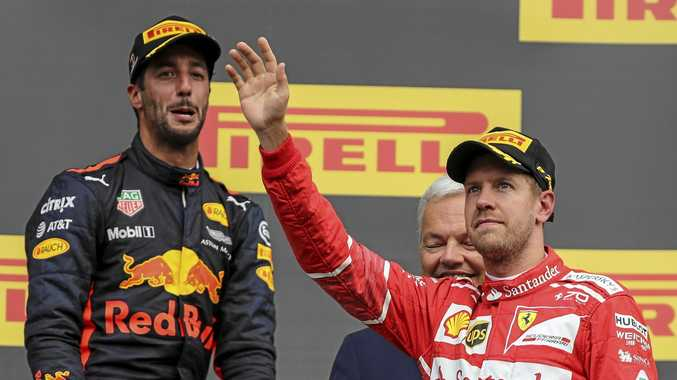 Daniel Ricciardo (left) and Sebastian Vettel on the podium after the Belgian GP.