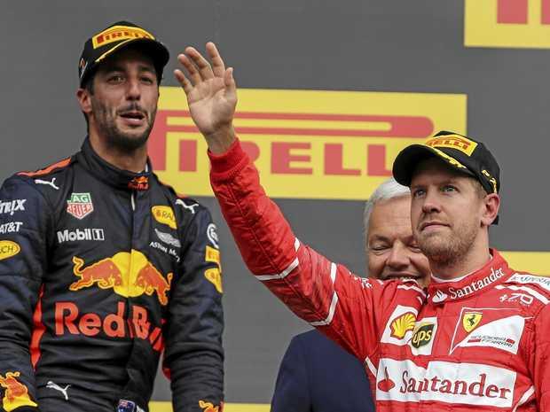 Daniel Ricciardo (left) and Sebastian Vettel on the podium after the Belgian GP.