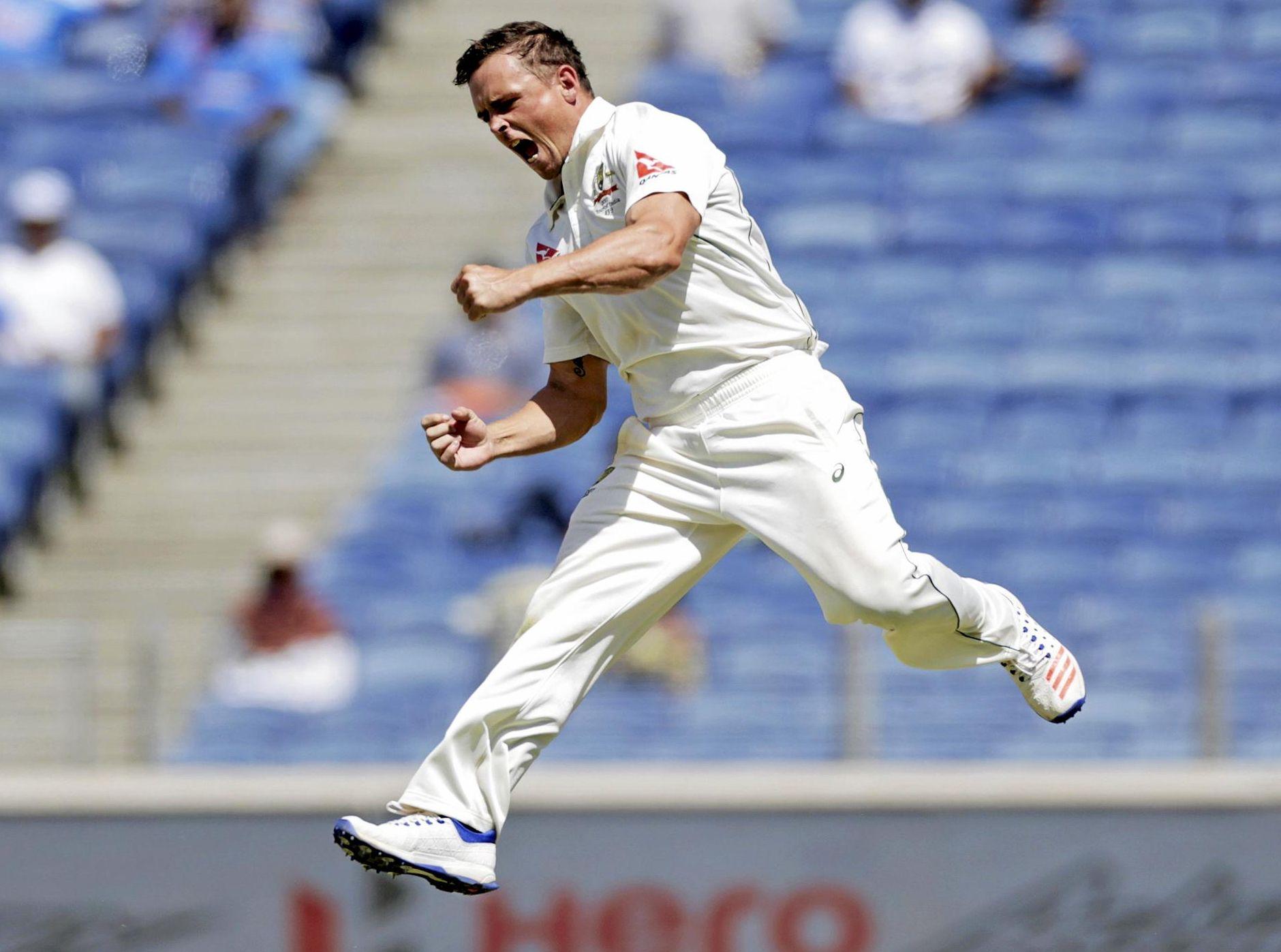 Australia's Steve O'Keefe celebrates the dismissal of India's Virat Kohli during the third day of the first Test.