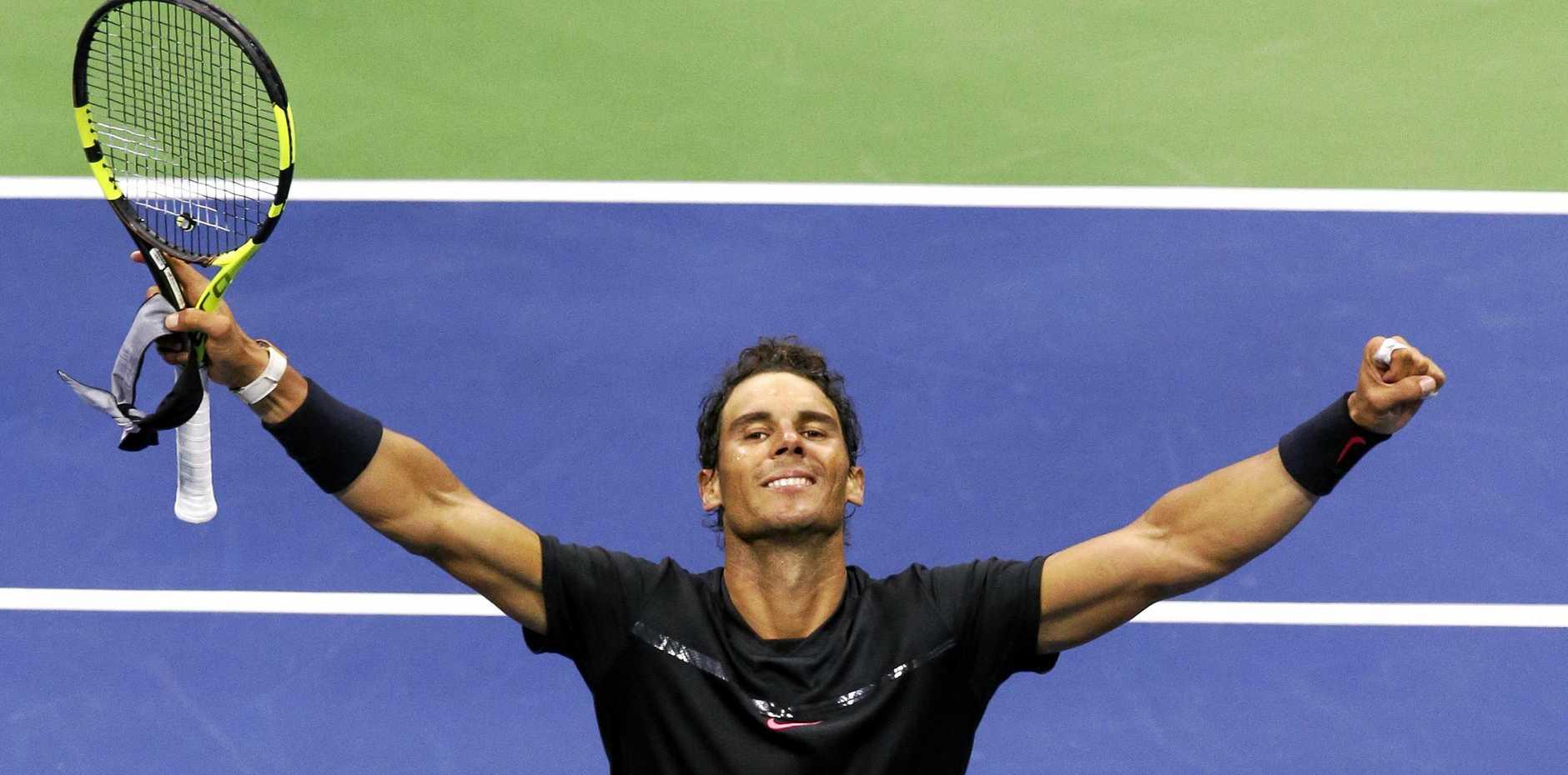 Rafael Nadal, of Spain, raises his arms after defeating Taro Daniel, of Japan, at the U.S. Open.