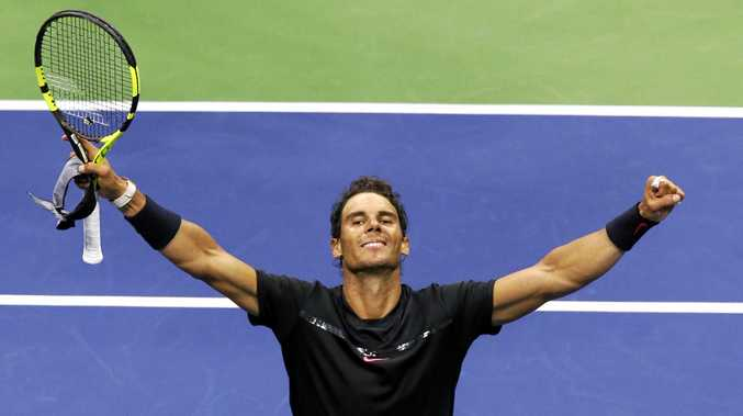 Rafael Nadal, of Spain, raises his arms after defeating Taro Daniel, of Japan, at the U.S. Open.