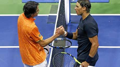 Rafael Nadal greets Taro Daniel the net after his win.