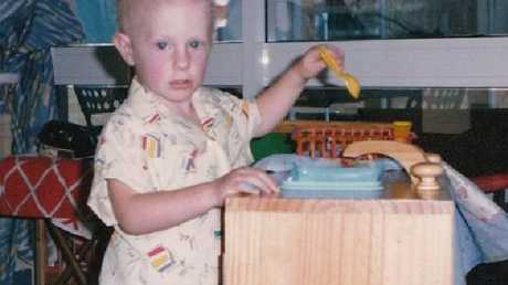 Michael Crossland pictured in hospital when he was two and a half years old.