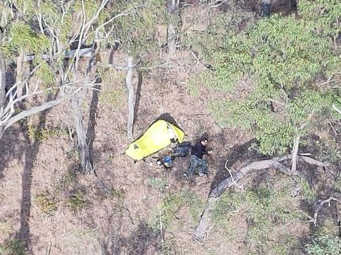 A trail bike rider stranded in bushland after a freak accident left him with a broken leg.