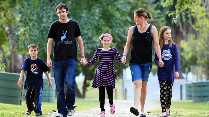 Dustin and Shannon Perry are fighting to save daughter Chloe (centre), who has brain cancer. Picture: Aaron Francis