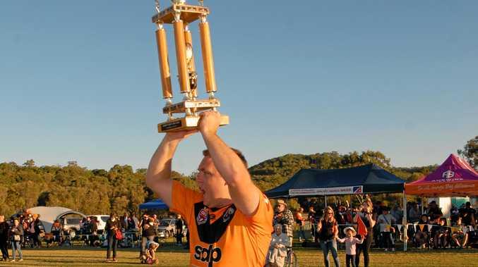 Avondale's Luke Owen lifts last year's trophy. The Hawks want to win it this year.