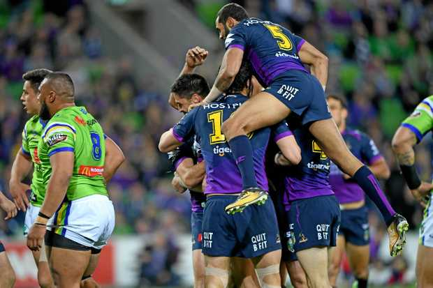 Teammates celebrate after Jesse Bromwich scores a try for the Storm on Saturday night.