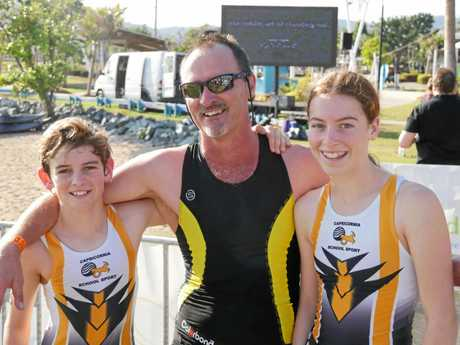 FAMILY CLEANS UP: Cameron (12), Murray and Jacqulyn Wonnocott (13) from Mackay- sibling duo placed 1st in enticer triathlon in their age groups with their father placing 3rd