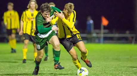 Western Pride's most capped senior men's footballer Joe Duckworth duels with a Moreton Bay United opponent in the NPL Queensland grand final.