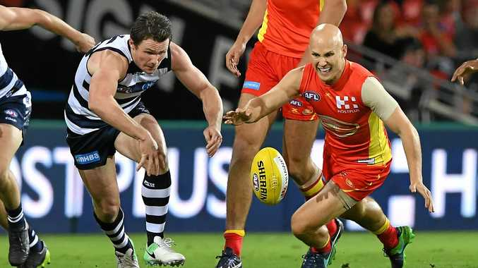 Geelong's Patrick Dangerfield (left) competes with Suns player Gary Ablett.