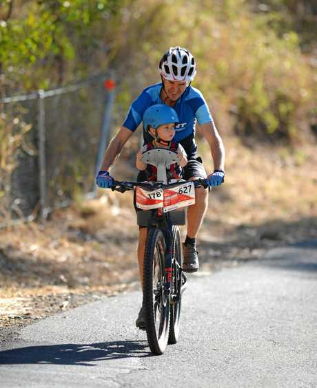 Joel Robinson with his son Fisher took to the bike for Challenge the Mountain this year.