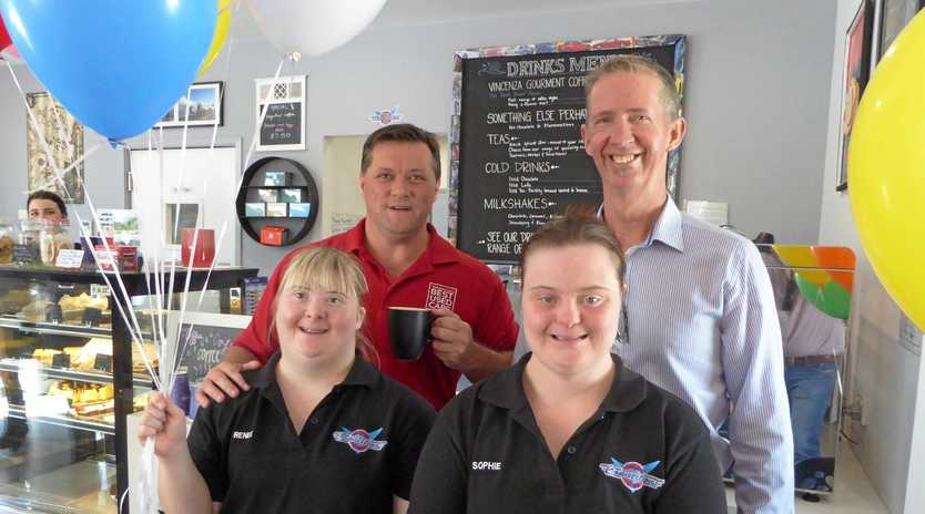 JOBS FOR ALL: Sunshine Coast social enterprise business Compass is setting a great example of how to engage people with disabilities in meaningful employment. Pictured at its Compass Connections Cafe are Matt Murray (Sunshine Coast's Best Used Cars), Compass CEO David Dangerfield and employees Renee and Sophie.
