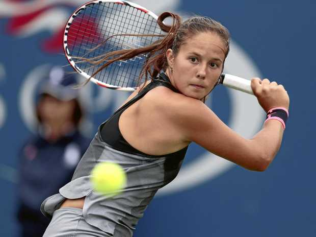 Darya Kasatkina, of Russia, returns a shot from Jelena Ostapenko, of Latvia, during the third round of the US Open.