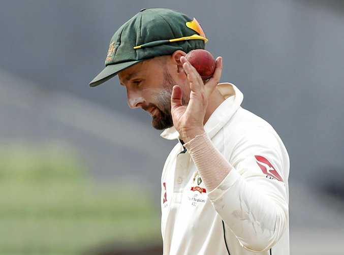 Australia's Nathan Lyon acknowledges the crowed after taking six Bangladeshi wickets during the third day of the first Test in Dhaka.