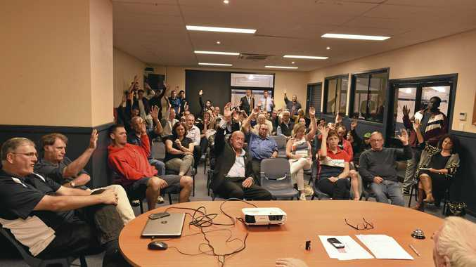 Attendees at the Toowoomba Mountaineers meeting to discuss staying in the QBL participate in a show of hands to recommend staying in the QBL, Tuesday, August 15, 2017.