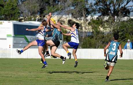 Bay Power's Josh Wheeler's attempted mark is spoiled. QFA Wide Bay Sunshine Coast: Bay Power v Pomona Demons at Keith Dunne Oval, Hervey Bay.