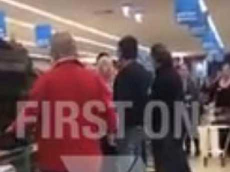 A shopper has filmed two families fighting over cheap furniture at an Aldi in Melbourne.