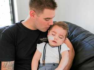 James Flaskas with two-year-old Tyler Flaskas. His rare mitochondrial condition affects bodily functions, from brain activity to sight and movement.
