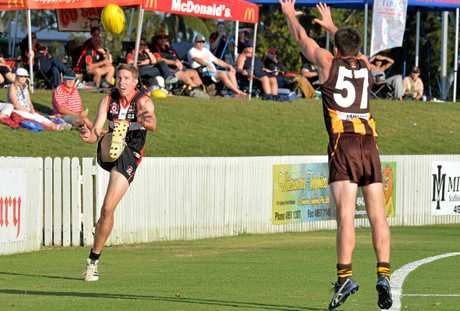 North Mackay Saints Sam Dunbar kicks towards the Hawks goal.